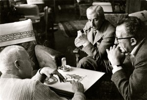 Robert Capa photo of: Howard Hawks, William Faulkner, and screenwriter Harry Kurnitz LEFT PHOTO: young William Falkner